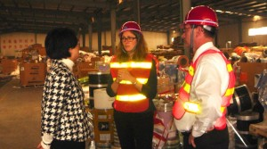 SPI member Kathy Xuan of PARC Corp., left, highlights China facility to SPI's Kim Holmes and Michael Taylor.